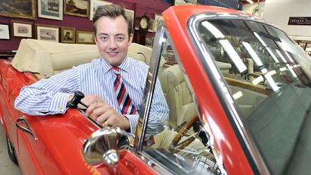 Reeman Dansie Auctioneer and valuer Jonathan Benson prepares to auction off a 1975 Rolls Royce conve
