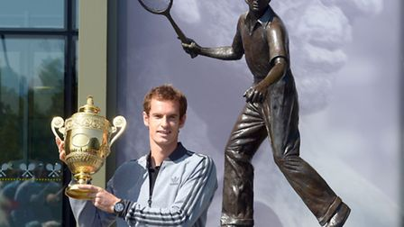 Great Britain's Andy Murray stands in front of the Fred Perry statue after winning the Wimbledon tit