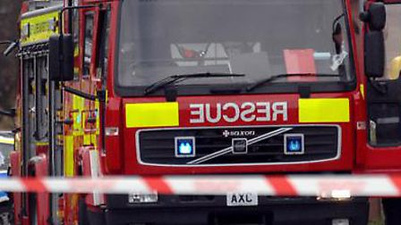 Firefighters tackle a blaze outside a home in Halstead