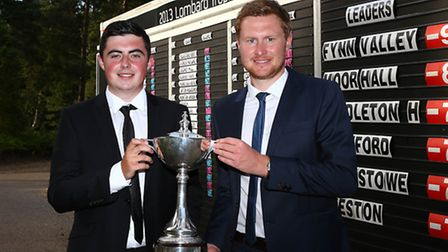 Professional Chris Smith of Fynn Valley GC (R) and amateur partner Kane Mayes pose after posting the