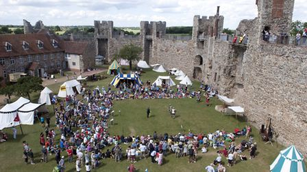 Framlingham Castle Knights event. A large crowd watch the knights do battle inside the castle walls