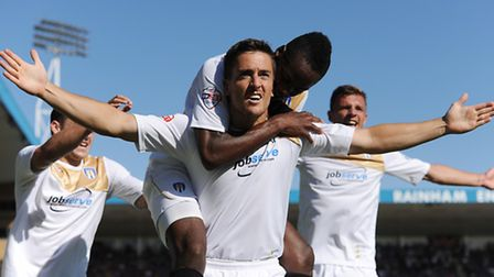 Andrew Bond (Colchester United) celebrates with Gavin Massey (Colchester United) after scoring to ma