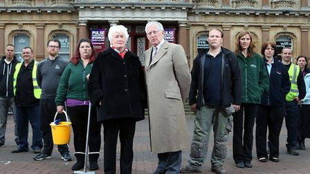 Nick Hewer and Margaret Mountford outside Cornhill with participants in a new show about benefits.