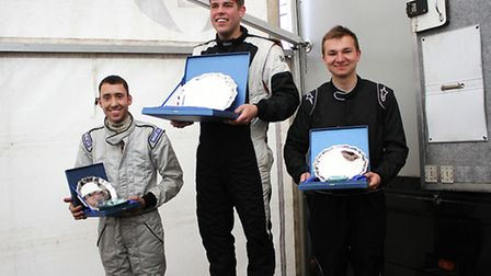 Leiston racing driver William Smith (centre) has won the opening three rounds of the Caterham Academ