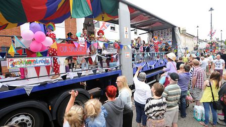 Stowmarket Carnival in full flow. The procession winds its way through the town.