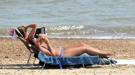 Cancer experts say people need to ensure they taje precautions when sunbathing.