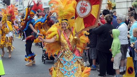 Colchester Carnival in full flow as the procession winds its way down the High Street.