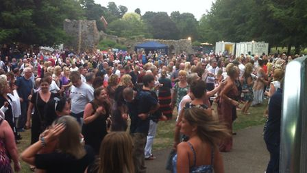 Some of the crowd at the second night of Abbeyfest, in Bury St Edmunds, dancing to Chic C'est Le Fre