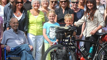 Jilly Sherlock, right, returned from a two-year round-the-world bike ride on Saturday. Just hours la