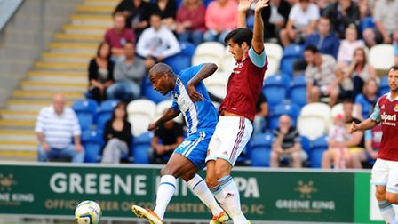 Clinton Morrison of Colchester United (L) shields the ball from James Tomkins of West Ham