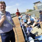 Colchester borough councillor Nick Barlow welcomes the Colne Explorer at the new pontoon in Hythe th