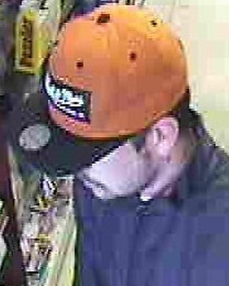 CCTV image of a man police would like to speak to following an attempted armed robbery in Lowestoft.