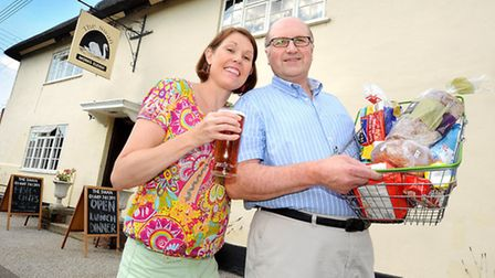 Carol and Nigel Robson outside their pub, Monks Eleigh Swan, which is a finalist in a national compe