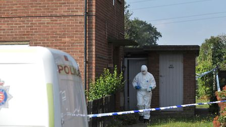 Forensics officers in Queen Elizabeth Way, Colchester yesterday.