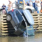 A couple were rescued from the car after it plunged into the river off Orford Quay