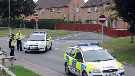 Police at the scene in Brooksfield in Bildeston after a man was found dead with stab wounds.