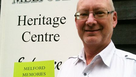 John Nunn, of Long Melford Heritage Centre with the reprinted version of Ernest Ambrose's local hist