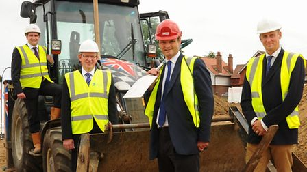 Waveney MP Peter Aldous, front, with the shovel as work starts on the multi-million pound Essex and