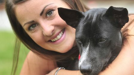 Elise Dixie of Felixstowe with Snooky the dog who she befriended while on mission in Cambodia