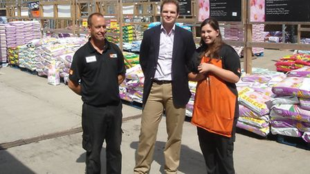 Dr Dan Poulter with Brian Tibbles and Amy Flatman at B&Q at Bury Road in Ipswich.