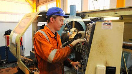 An apprentice at work in the milling and boring departmen at AKD Engineering.