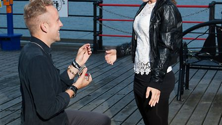 Dale Connelly proposes to Catherine Scott on Southend Pier, after a little help from some unusual pi