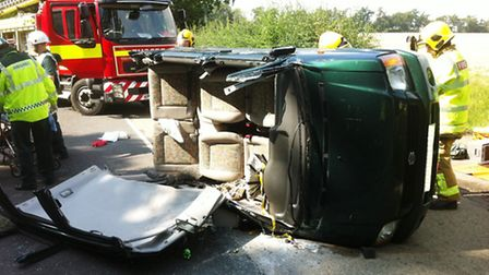 Two men were trapped for an hour following a collision in Rougham