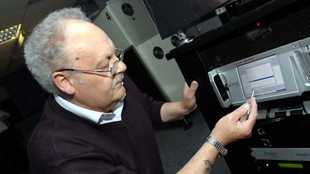 Projectionist, Ron Littlewood, programming a new digital projector. Films arrive on a computer drive