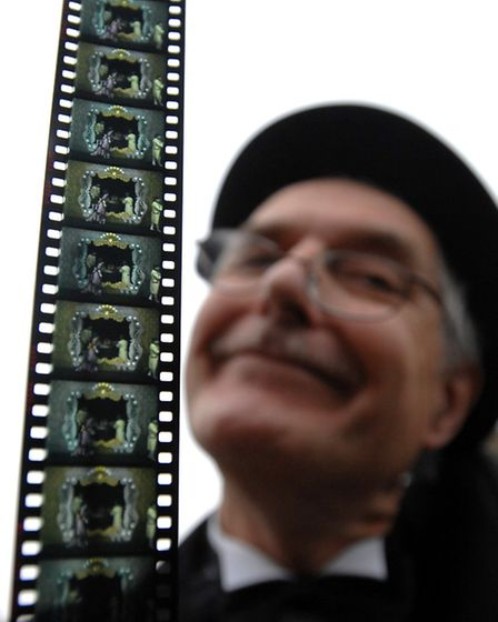Nigel Lister with some old film which is now largely redundant. Digital downloads mean that niche a