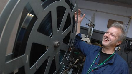 Steve Mann with one of the large 35mm projectors at Ipswich Film Theatre. Traditional film is now a