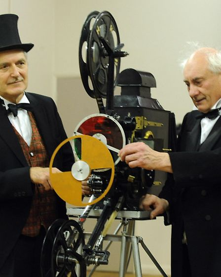 David Cleveland, right, and Nigel Lister demonstrating an old renovated film projector from the ear