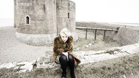 Singer-songwriter Gwyneth Herbert braving the winter winds by Aldeburgh's Martello Tower. She was in