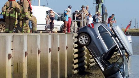 Two motorists were plucked to safety after their car plunged off Orford Quay and into the river. Pho