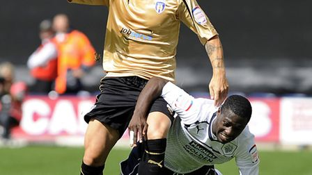 Former U's left-back Michael Rose battles with Preston winger Jeffrey Monakana, who has today signed