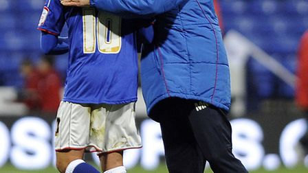 Michael Chopra gets a pat on the back from Ipswich Town manager Mick McCarthy last season