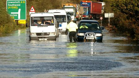 Motorists battle through the floods on the A12 at Blythburgh. Suffolk County Council have announced