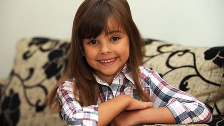 Seven year old Maria Fiske has been signed to a London modelling agency. Maria is pictured at home i