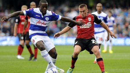 Paul Taylor is kept from the ball at Loftus Road