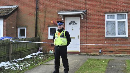 A police officer outside the home in Hogarth Road where Jade Bagley's body was discovered by her boy