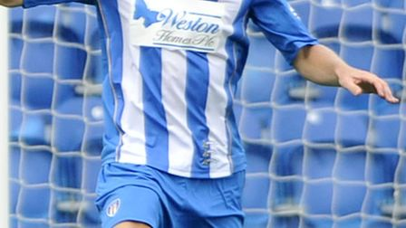 Colchester United loanee Matt Taylor, in action against Crawley Town