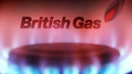 File photo dated 20/04/07 of a British Gas bill behind a burning hob as British Gas owner Centrica h