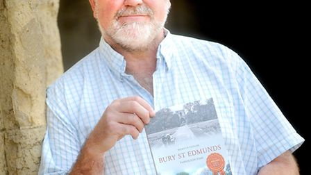 Local history guide Martyn Taylor with his new book 'Bury St Edmunds Through Time'.