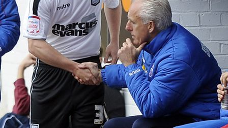 Ipswich Town manager Mick McCarthy shakes the hand of Jack Marriott as the youngster prepares to mak