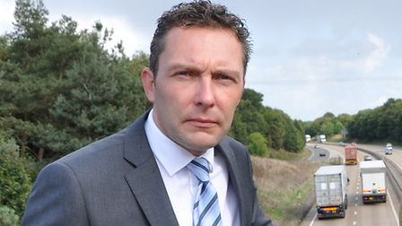 Suffolk Chamber chief executive John Dugmore by the A14.