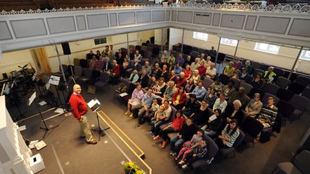 The first service at Woodbridge Quay Church. Rev Mark Hardingham on the stage.