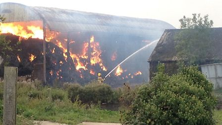 A barn containing over 750 tonnes of straw on fire in Ashbocking, Suffolk