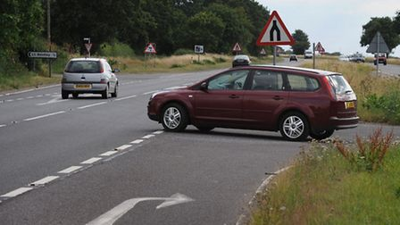 The Highways Agency is introducing 50mph speed limits and safety cameras on a notorious stretch of t