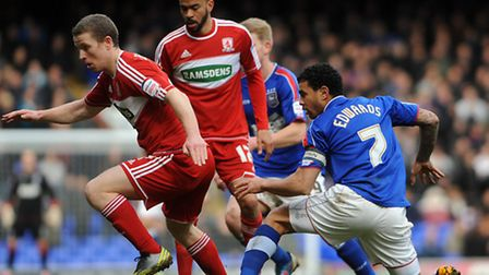 Ex Ipswich Town duo Grant Leadbitter and Kieron Dyer battle with Blues skipper Carlos Edwards in mid
