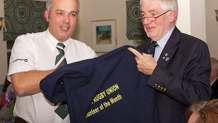 Ray Collins, the president of Suffolk RFU, presents Kevin Stannard with Suffolk RFU's volunteer of t