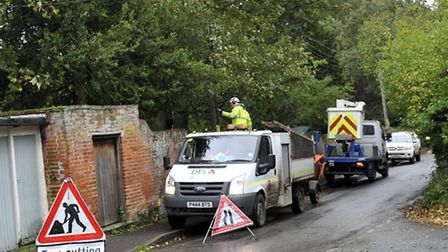 Tree cutters work on areas hit by the storm on Monday which caused power outages throughout Ufford.